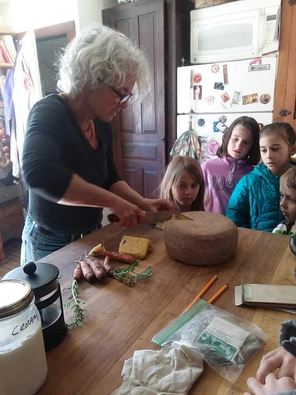 beth hands out home made cheese at farm tour
